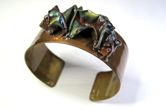 flame paint copper The cuff is flame painted with a jewelry torch and covered by a protective coat adjustable Copper Bracelet