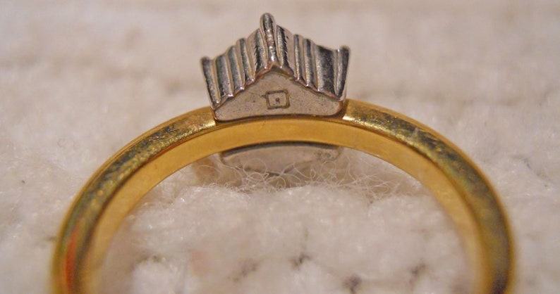 Ring The stones are set in white tone metal and the shank is gold tone Center stone and 6 other Yellow and Silver Tone Metal Size 6.75