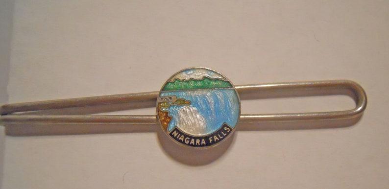Unique Niagara Falls Oar Tie Bar Tie Bar Silver Tone Metal Niagara Falls Enameled Round Emblem in the Center