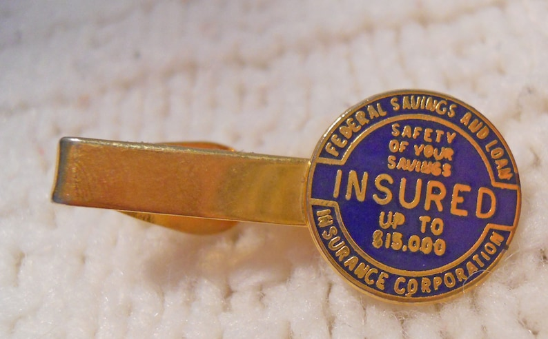 INSURED Up to 15,000 Tie Bar Safety of Your Savings Gold Tone Metal Company Tie Bar Federal Savings and Loan Insurance Corporation