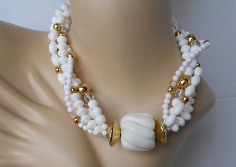 Wow 20 Inch Statement Necklace white plastic stones intertwined with clear crystals and gold tone metal beads Necklace