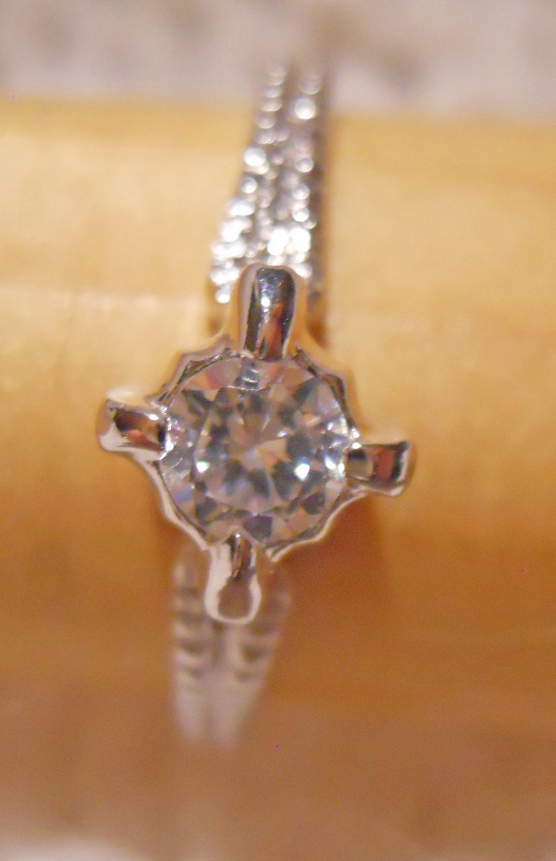 Stone Prong Set and Coin Edging on the Double Strand Band Sophisticated and Innocent Silver Tone Metal Crystal Ring Ring Size 9