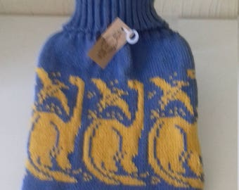 Handmade knitted hot water bottle cover featuring 2 Dinosaurs - Pterosaur and a Diplodocus, includes hot water bottle.