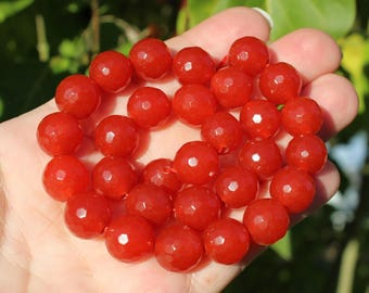 2 RUBY RED 12 MM AAA FACETED BEADS.