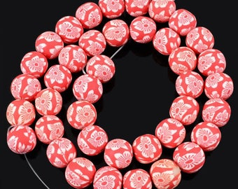 4 RED WHITE FLOWER POLYMER CLAY BEADS. 11MM.