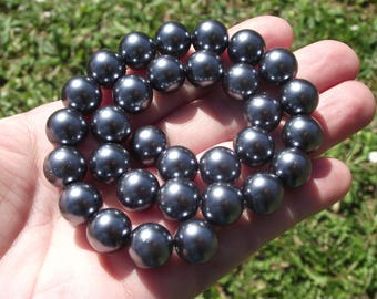 4 round 12MM dark grey shell beads. ***
