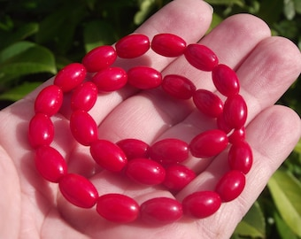 4 BEADS, RICE, OVAL RED CORAL. 10X7MM.