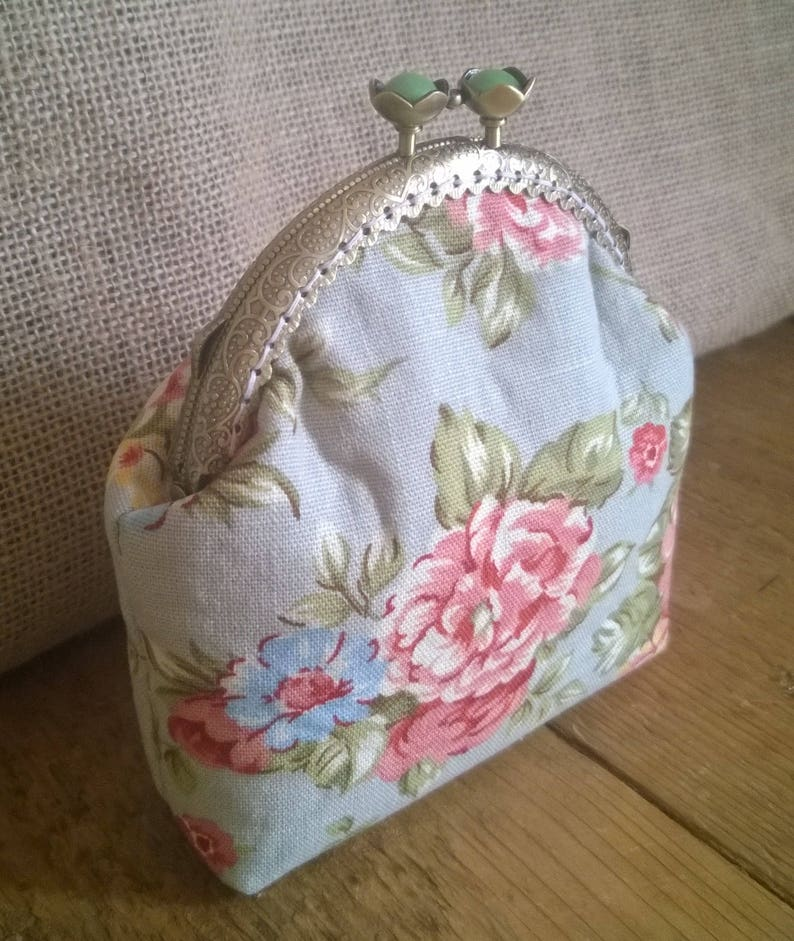 Purse with flower detail. with added lace detail Hand Made coin purse made with a sew in purse frame
