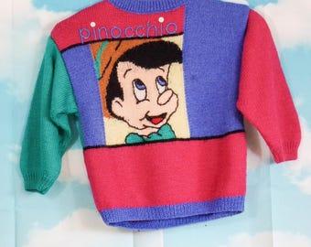 Pull kid rose bleu vert tricoté main Motif Pinocchio 5 ans