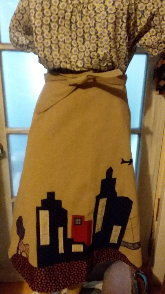 Vintage 1970's corduroy wrap a round skirt with applique of trees, a city, bridge, and factory. Size Medium. Great condition!
