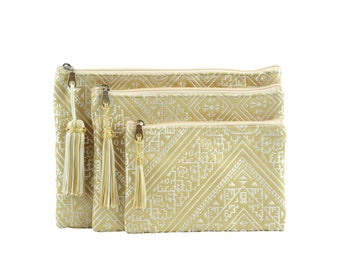 Three Moroccan pouches, gold clutch bag, purple cosmetic bag, toiletry bag, electronic pouch, gold embroidered fabric, gold tassel