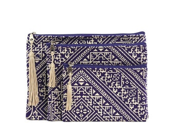 Three Moroccan pouches, violet clutch bag, purple cosmetic bag, toiletry bag, electronic pouch, violet embroidered fabric, golden tassel