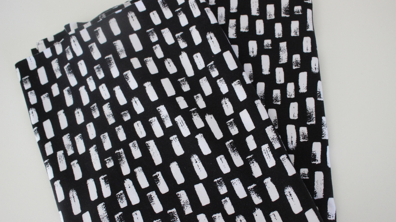 Baumwollsweat  50 x 150 grau//schwarz Swafingstoff