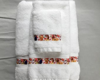 Hooded bath towel with an embroidered Beast on it.