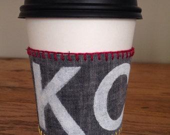 KC coffee cup sleeve