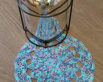 Handmade round variegated ornate doily