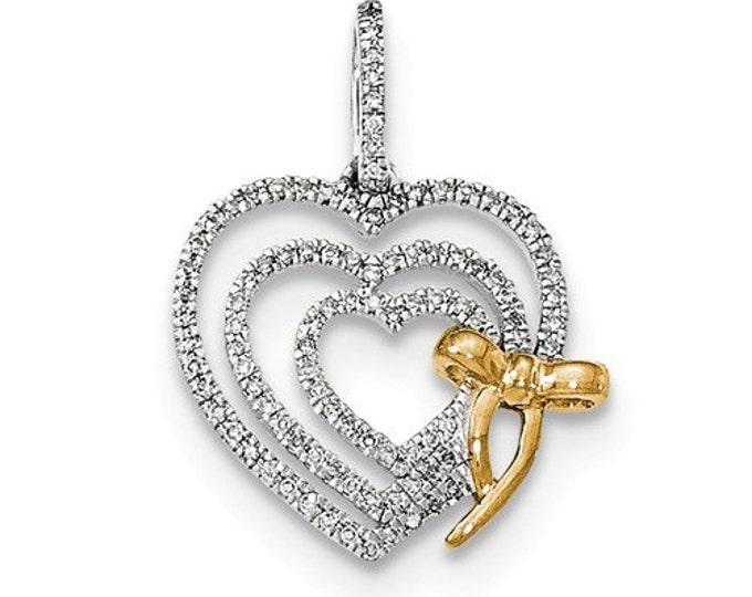 14 Karat Two Tone Gold Diamond Heart with Bow Pendant.
