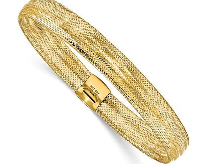 Stunning 8.50mm Wide High Polish 14 Karat Yellow Gold Stretch Bangle Bracelet.