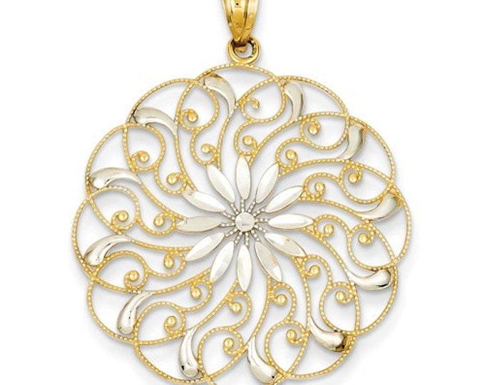 14 Karat Yellow & White Gold Diamond Cut Fancy Swirl Pendant.