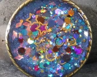 Resin brooch, shimmery stars