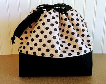 Black dotted Drawstring Knitting bag with sheep print lining.
