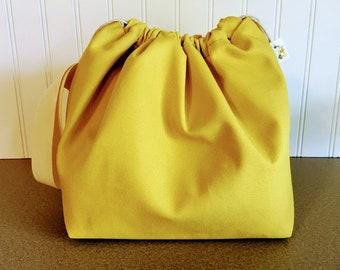 Yellow Canvas Drawstring Bag with sheep lining.