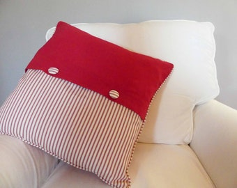 Red and cream striped, piped, buttoned cushion cover