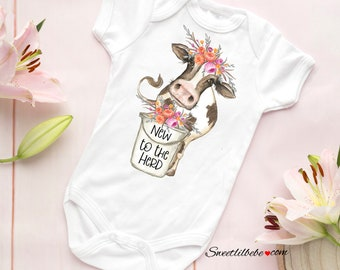 ad91661a7446 New To The Herd Baby Girl Onesie®