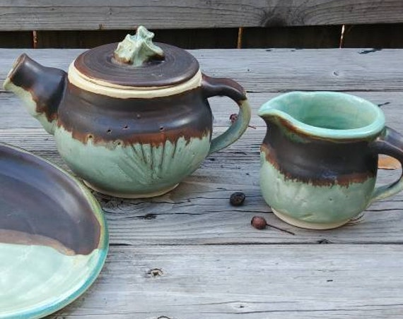 Pottery Tea Pot, Creamer, and Two Plates