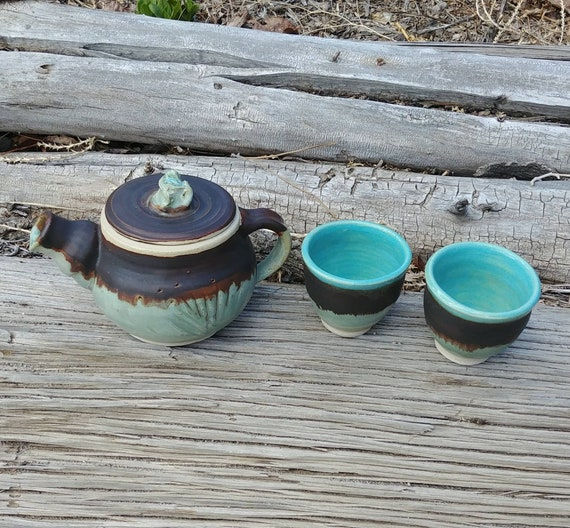Pottery Tea Pot, Two Cups, Creamer, and Two Plates
