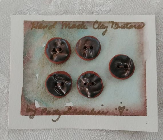Five Clay Buttons on a Card