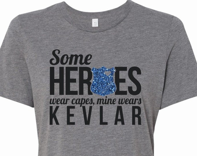 Some Heroes Wear Capes Mine Wears Kevlar - T-Shirt
