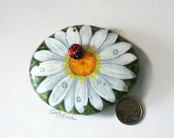 Painted white daisy stone, gerbera daisy with ladybug, flower painted rock, garden decor, white daisy flower, painted rock, ladybird pebble