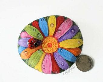 Rainbow painted daisy rock, gerbera daisy with ladybug, colorful flower painted stone, garden decor, pride daisy rock, ladybird pebble art