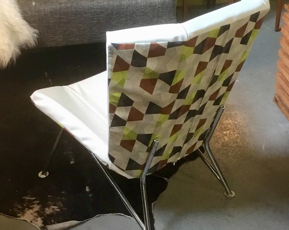 Newly recovered funky 1960s chrome, vinyl, and fabric wingback chair