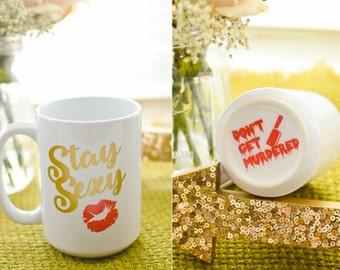 Stay Sexy. Don't Get Murdered. Standard mug. My Favorite Murder Inspired.