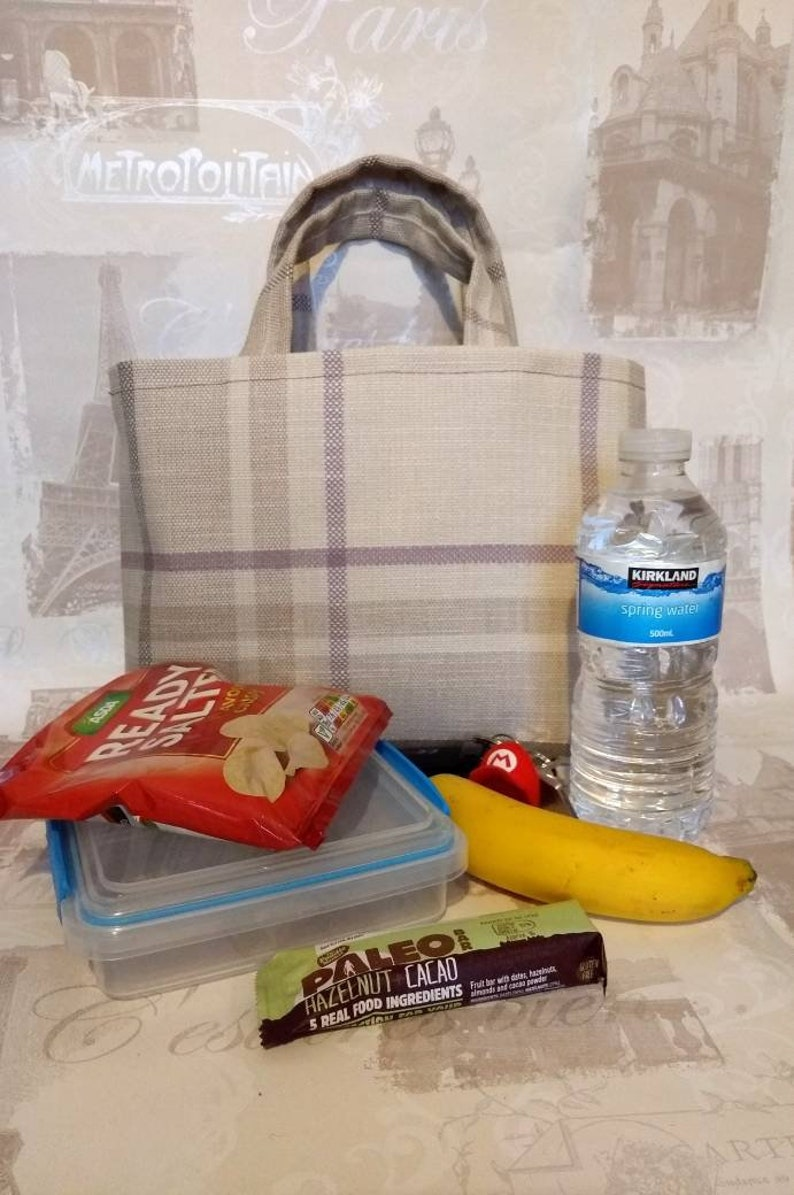 A Hand made lunch bag made from remnant and recycled fabric  An eco bag  made from remnant and waste fabric saved from landfill