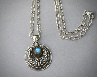 I am the Storm Labradorite Crescent Moon pendant in Sterling silver