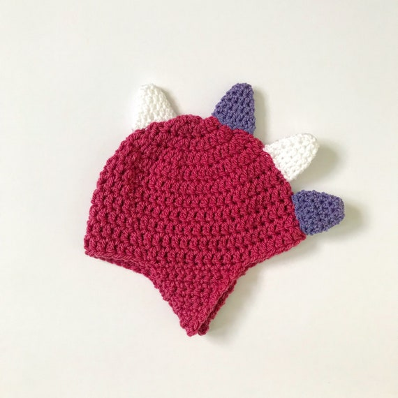 be7c80f8469 Pink dinosaur beanie hat with purple and white spikes