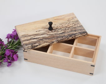 Box with spalted lid and leather lining.
