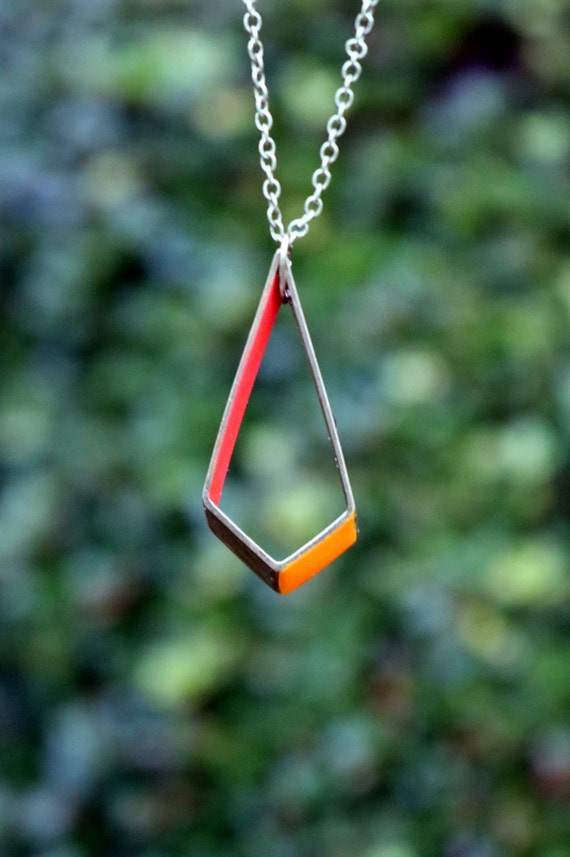 Will you be the one to stay fused with Jasper? Cross your fingers for the next redemption arc in this minimalist necklace inspired by Steven Universes ultimate quartz, Jasper. Jaspers diamond gem features a high-gloss enamel painted dark orange inner band and a light orange outer