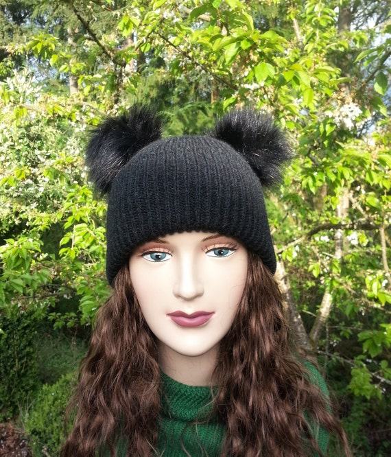 Black Double Fur Pom Knit Hat. Women s knitted hat with  529fd9fad