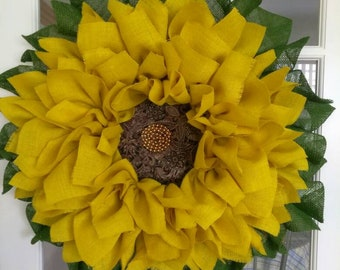 Americana Sunflower, bright yellow,medium green leaves, beautiful 32inches in diameter!!It is absolutely beautiful!!  For spring or summer.