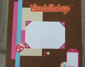 """Baby page""""Cuddlebug""""; child page;  12x12 scrapbook page; lady bug; brown, pink and blue"""