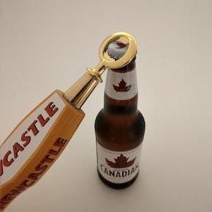 Beer tap  Bottle openers edmond fitzgerald Bar used beer tap made into a bottle opener.