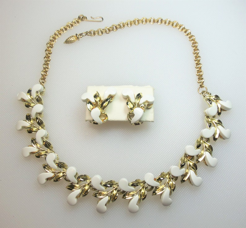 Vintage Polished Gold Tone White Thermoset Plastic Adjustable Necklace with Hook Closure and Matching Clip Earrings Set