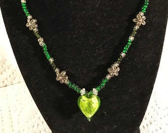 Silver flower, hearts and green beaded necklace