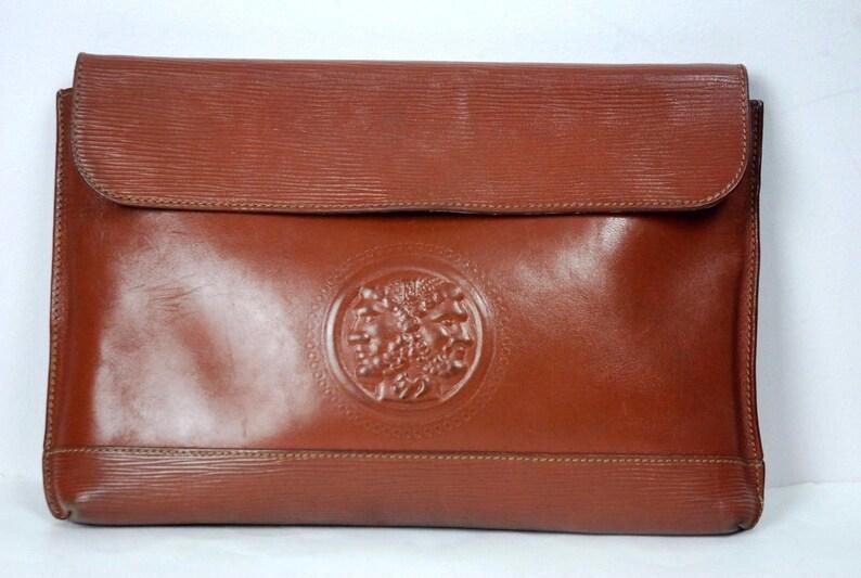 dd4cb20b3b63 Vintage FENDI Janus God embossed brown leather pouch clutch