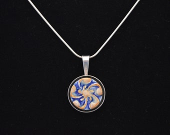 Swirl ceramic pendant in sterling silver shadowbox