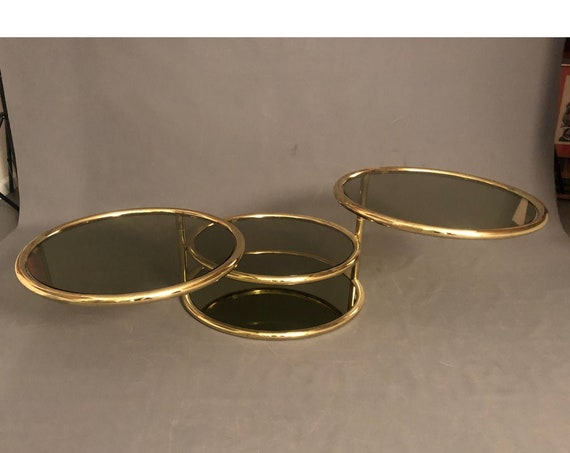 Mid Century Hollywood Regency Milo Baughman Style Swivel Brass and Glass Coffee Table
